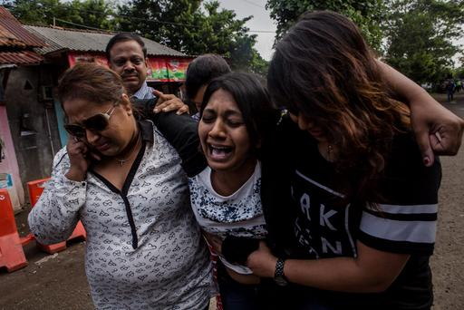 Brintha Sukumaran, a sister of Australian death row prisoner Myuran Sukumaran's screams as she arrives at Wijaya Pura port to visit her brother at Nusakambangan prison ahead of the executions of the Bali 9 on April 28, 2015 in Cilacap, Central Java, Indonesia. (Photo by Ulet Ifansasti/Getty Images)