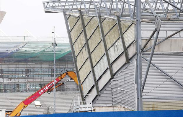 Work begins to demolish the Kop stand at Windsor Park in Belfast.