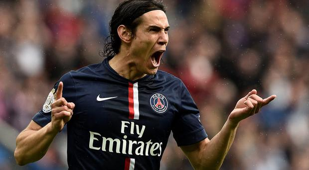 Paris Saint-Germain's Uruguyan forward Edinson Cavani celebrates after scoring a goal