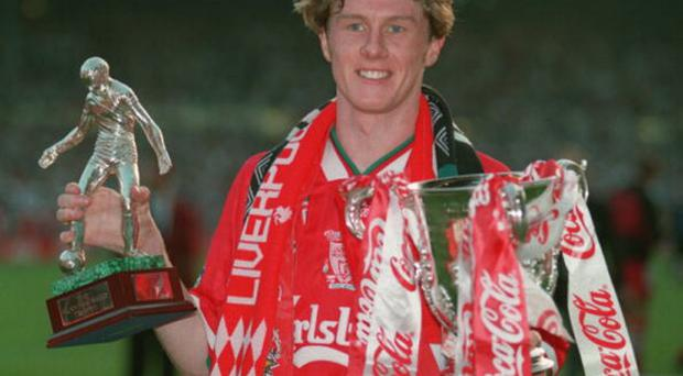 2 APR 1995: STEVE MCMANAMAN OF LIVERPOOL HOLDS THE COCA COLA CUP TROPHY IN HIS LEFT HAND AND THE MAN OF THE MATCH TROPHY IN HIS RIGHT HAND