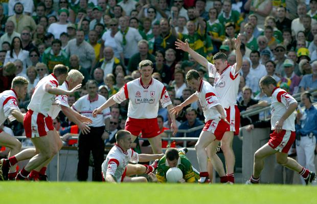 Outnumbered: Tyrone employ their defensive tactics against Kerry in 2003