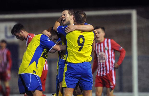 On target: Bangor's Paul McDowell celebrates his injury time play-off goal against Warrenpoint Town