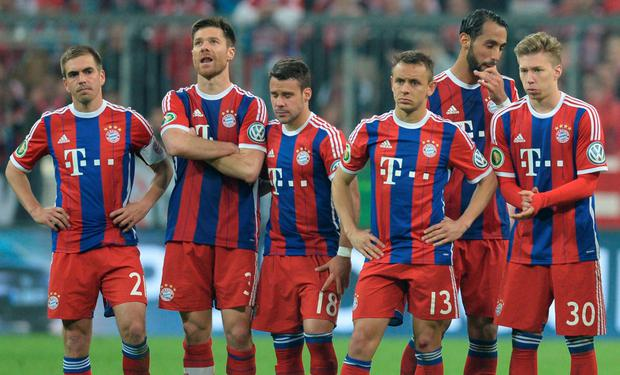 Bayern Munich's players react during the penalty shoot-out of the German Cup DFB Pokal semi-final football match FC Bayern Munich v Borussia Dortmund
