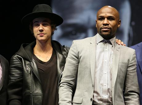 Justin Bieber appears on stage with Floyd Mayweather Jr