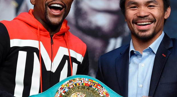 Belt up: Floyd Mayweather and Manny Pacquiao clash tomorrow night in Las Vegas