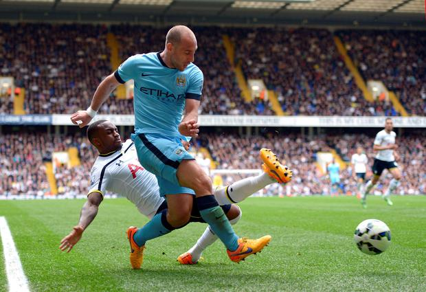 Tottenham Hotspur's Danny Rose (left) and Manchester City's Pablo Zabaleta battle for the ball during the Barclays Premier League match at White Hart Lane, London. Adam Davy/PA Wire.