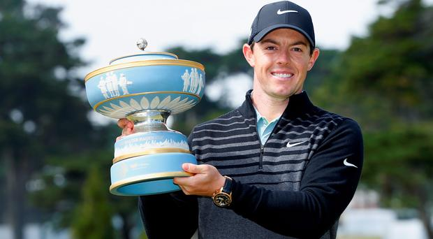 SAN FRANCISCO, CA - MAY 03: Rory McIlroy of Northern Ireland lifts the Walter Hagen Cup after defeating Gary Woodland 4&2 in the championship match of the World Golf Championships Cadillac Match Play at TPC Harding Park on May 3, 2015 in San Francisco, California. (Photo by Christian Petersen/Getty Images)