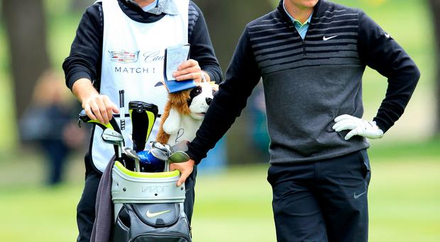 SAN FRANCISCO, CA - MAY 03: Rory McIlroy of Northern Ireland waits to play his second shot on the par 4, 6th hole with his caddie J.P.Fitzgerald during his championship match in the World Golf Championships Cadillac Match Play at TPC Harding Park on May 3, 2015 in San Francisco, California. (Photo by David Cannon/Getty Images)