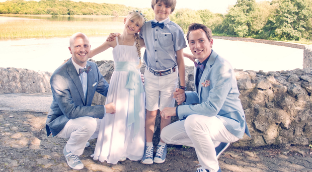 George Clarke with his husband Kenny, daughter Tobyn and son Leo pictured at their wedding at Knockninny Country House and Marina last summer