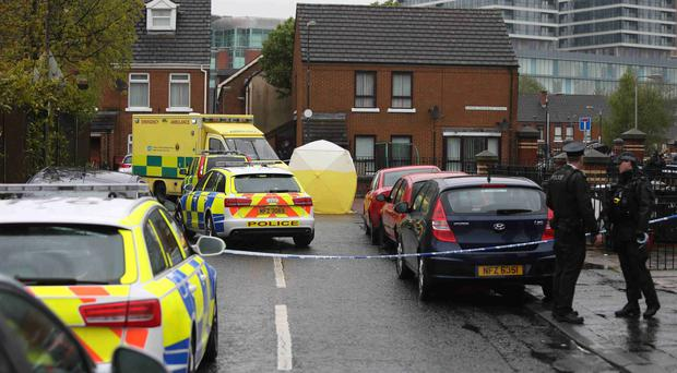 Police conduct their investigation in the Markets area of Belfast