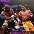 US boxer Floyd Mayweather Jr., (L) and Manny Pacquiao of the Philippines fight during their welterweight unification boxing bout at the MGM Grand Garden Arena in Las Vegas