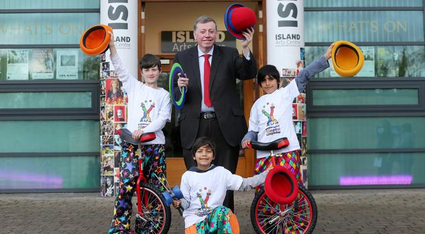 Paul Porter, chair of Lisburn and Castlereagh City Council's leisure services committee, with members of Community Circus Lisburn, Dean Grimley, Hasan and Samir Javed