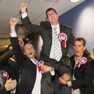 DUP's Paul Givan and Edwin Poots raise Jeffrey Donaldson as he wins the Lagan Valley seat