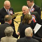 Press Eye - Belfast - Northern Ireland 7th May 2015 - East Antrim and South Antrim constituency counts at Valley Leisure Centre, Newtownabbey. Danny Kinnehan shakes the hand of Willie McCrea who he replaced as MP of South Antrim Picture by Stephen Hamilton / Press Eye.