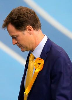 SHEFFIELD, ENGLAND - MAY 08: Liberal Democrat leader and Deputy Prime Minister Nick Clegg looks dejected as they leave his constituency declaration at the English Institute of Sport. (Photo by Dave Thompson/Getty Images)