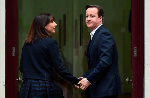 David Cameron and his wife Samantha arrive at Conservative Party headquarters the day after the 2015 general election.
