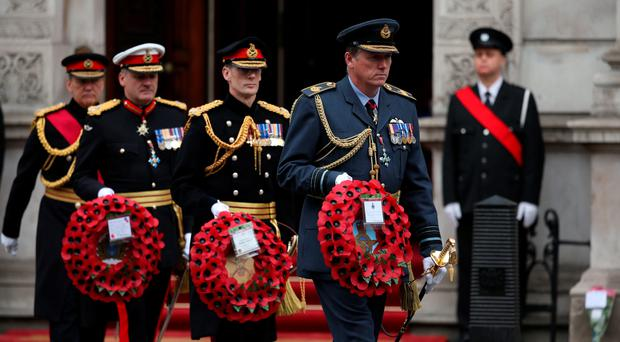 Members of the military carry wreaths during a Service of Remembrance to mark the 70th anniversary of VE Day, at the Cenotaph, in Whitehall, London. Dan Kitwood/PA Wire.