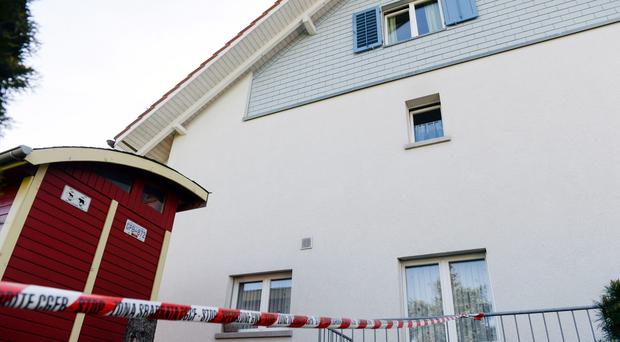 Police have sealed off house in Wuerenlingen, Switzerland where several people were found dead after shots were heard shortly after 11pm Saturday. (Walter Bieri/Keystone via AP)