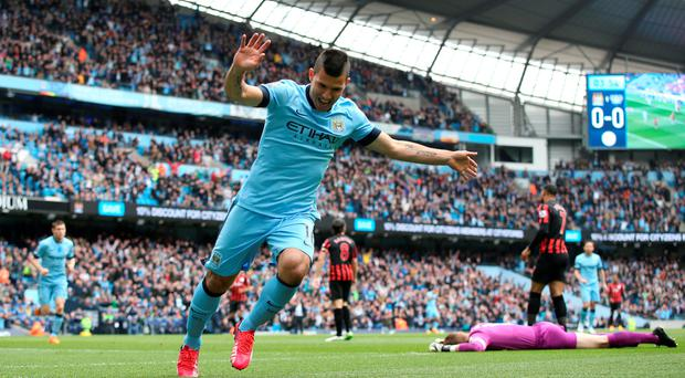 Manchester City's Sergio Aguero celebrates scoring his side's first goal of the game during the Barclays Premier League match at the Etihad Stadium, Manchester. Lynne Cameron/PA Wire.