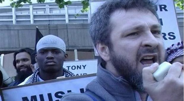 Irish Muslim Khalid Kelly pictured with Fusilier Lee Rigby killer Michael Adebolajo, in white skull cap.