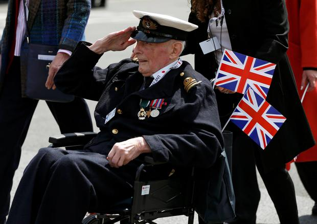A veteran salutes as he takes part in the VE Day Parade to mark the 70th anniversary of VE Day, at Parliament Square in London. Phil Noble/PA Wire.