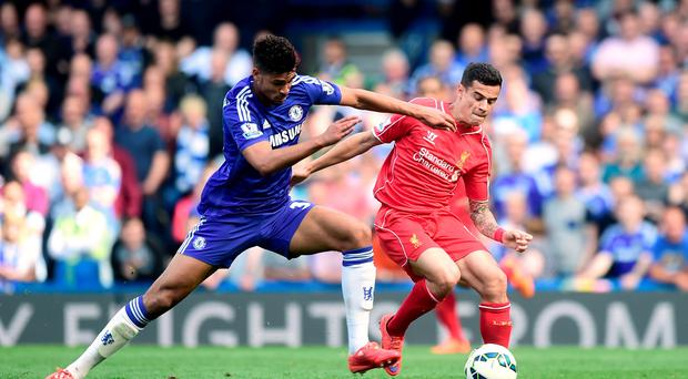 Chelsea's Ruben Loftus-Cheek and Liverpool's Philippe Coutinho (right) battle for the ball during the Barclays Premier League match at Stamford Bridge, London. Adam Davy/PA Wire.