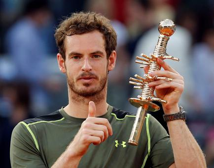 Andy Murray of Britain holds up the winners trophy after defeating Rafael Nadal of Spain in their men's singles final match at the Madrid Open Tennis tournament in Madrid, Spain, Sunday, May 10, 2015. Murray defeated Nadal 6-3, 6-2. (AP Photo/Paul White) )