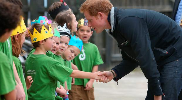 Britain's Prince Harry meets with pupils during a visit to Halfmoon Bay school on Stewart Island as part of his first visit to New Zealand.