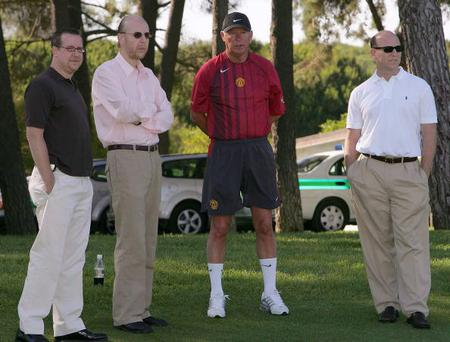 Sir Alex Ferguson of Manchester United (2nd R) talks to Bryan Glazer (L), Avram Glazer (2nd L) and Joel Glazer (R) during a pre-season first team training session on July 1, 2005 in Vale do Lobo, Portugal.