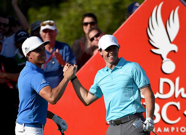 Rory McIlroy of Northern Ireland celebrates his 'hole-in-one' with Rickie Fowler of the USA on the par three 15th hole during the second round of the Abu Dhabi HSBC Golf Championship at the Abu Dhabi Golf Club on January 16, 2015 in Abu Dhabi
