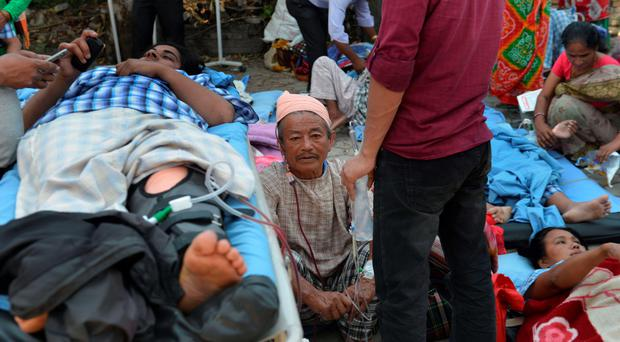 Nepalese patients lie on stretchers in an open area after being carried out of a hospital building as a 7.3 magnitude earthquake hits the country, in Kathmandu on May 12, 2015. A 7.3-magnitude earthquake hit devastated Nepal, sending terrified residents running into the streets in the capital Kathmandu, according to witnesses and the US Geological Survey. The quake struck at 12:35pm local time in the Himalayan nation some 83 kilometres (52 miles) east of Kathmandu, more than two weeks after a 7.8-magnitude quake which killed more than 8,000 people. AFP PHOTO / PRAKASH MATHEMAPRAKASH MATHEMA/AFP/Getty Images