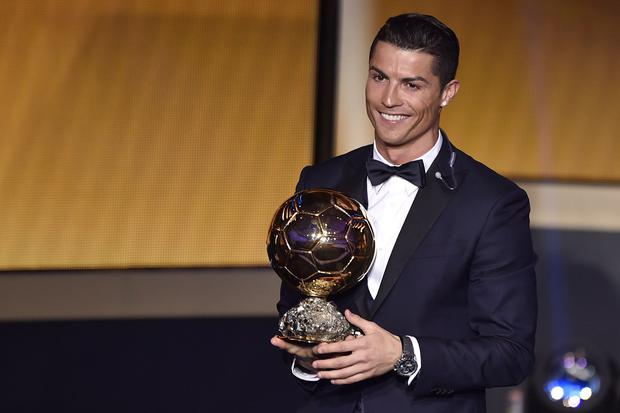 Cristiano Ronaldo smiles after receiving the 2014 FIFA Ballon d'Or award for player of the year during the FIFA Ballon d'Or award ceremony at the Kongresshaus in Zurich on January 12, 2015.