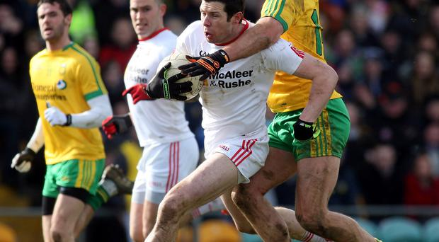 Hands-on approach: Tyrone's Sean Cavanagh and Michael Murphy of Donegal will lock horns again in the Ulster Championship