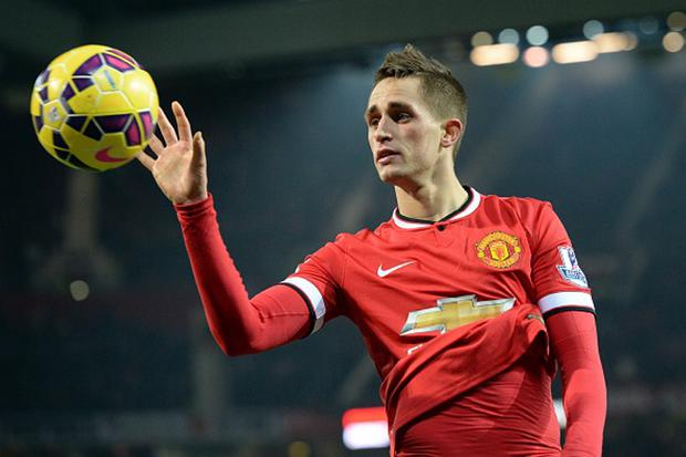 Manchester United's Belgian midfielder Adnan Januzaj catches the ball during the English Premier League football match between Manchester United and Burnley at Old Trafford in Manchester, north west England, on February 11, 2015. Manchester United won the game 3-1. AFP PHOTO / OLI SCARFF RESTRICTED TO EDITORIAL USE. No use with unauthorized audio, video, data, fixture lists, club/league logos or live services. Online in-match use limited to 45 images, no video emulation. No use in betting, games or single club/league/player publications. (Photo credit should read OLI SCARFF/AFP/Getty Images)