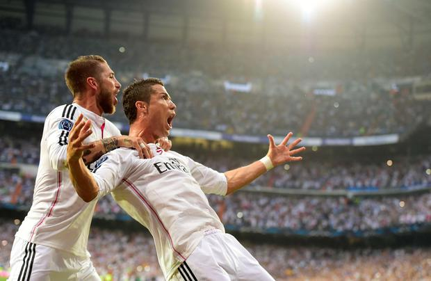 Real Madrid's Portuguese forward Cristiano Ronaldo (R) celebrates with Real Madrid's defender Sergio Ramos after scoring during the UEFA Champions League semi-final second leg football match Real Madrid FC vs Juventus at the Santiago Bernabeu stadium in Madrid on May 13, 2015. AFP PHOTO/ GERARD JULIENGERARD JULIEN/AFP/Getty Images