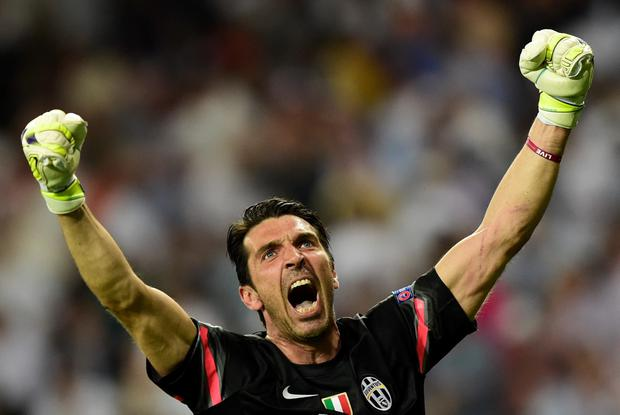Juventus' goalkeeper and captain Gianluigi Buffon celebrates winning the UEFA Champions League semi-final second leg football match Real Madrid FC vs Juventus at the Santiago Bernabeu stadium in Madrid on May 13, 2015. AFP/Getty Images