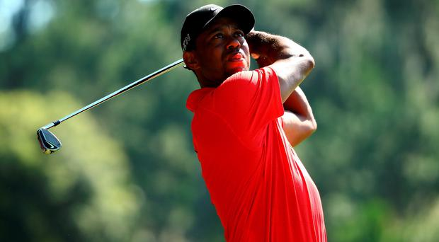 Tiger Woods plays his second shot on the sixth hole during the final round of THE PLAYERS Championship at the TPC Sawgrass Stadium course on May 10, 2015 in Ponte Vedra Beach, Florida