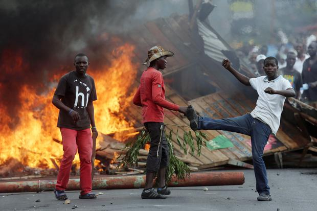 Demonstrators face off with riot police in the Musaga district of Bujumbura, Burundi (AP Photo/Jerome Delay)