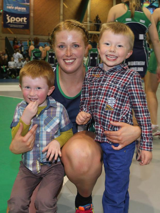 Family support: Northern Ireland's Lisa Bowman, who netted 43 of 50 shots in the draw with Wales at Antrim Forum, with sons Charlie (left) and Harry