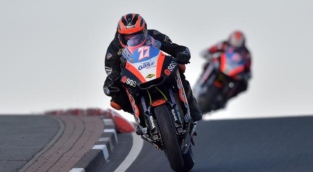 14/5/2015. PACEMAKER PRESS INTL NW200. SUPERTWINS RACE. Ryan Farquhar leads from Jeremy McWilliams on the final lap during this evenings NW200 Supertwins race. PICTURE CHARLES MCQUILLAN/PACEMAKER.
