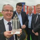Cookstown pork manufacturing company Karro was Henderson Wholesales Overall Local Supplier of the Year at the companys awards held at the Balmoral Show. From left, Alistair McQuillan from Karro; Neal Kelly, Fresh Food Director, Henderson Wholesale; Paddy Doody, Sales and Marketing Director Henderson Wholesale; and Gordon Quinn from Karro.