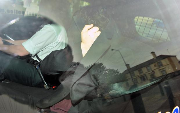 Padraig O'Neill arriving at Newtownards Court in the back of a police car, charged with sexually assaulting three women in what he claimed were 'sharking' incidents. Pic Justin Kernoghan