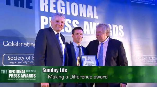 Sunday Life editor Martin Breen collects the Making a Difference award at the UK Regional Press Awards.