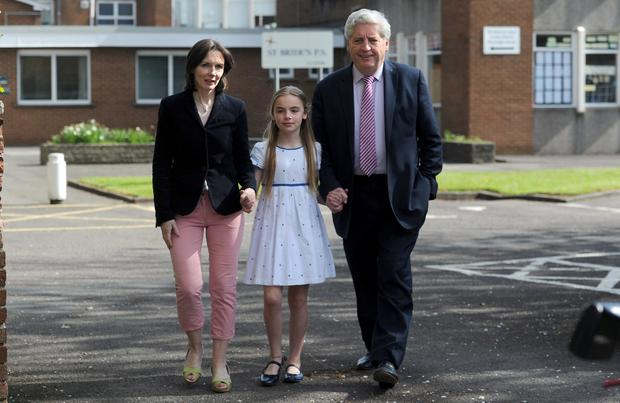 Alasdair McDonnell and his wife Olivia Nugent on their way to vote at St Brides PS in South Belfast, with daughter Aileen