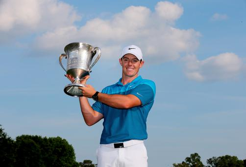 Rory McIlroy of Northern Ireland poses with the trophy after his win on the 18th hole during the final round at the Wells Fargo Championship at Quail Hollow Club on May 17, 2015 in Charlotte, North Carolina.