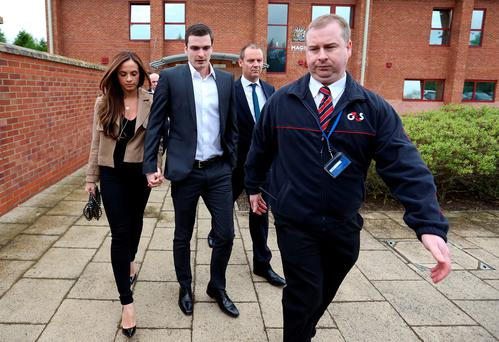England footballer Adam Johnson (second left) and his partner Stacey Flounders leave Peterlee Magistrates' Court in County Durham