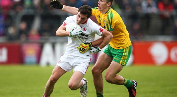 Electric Ireland Ulster GAA Football Minor Championship First Round, Ballybofey, Donegal 17/5/2015 Donegal vs Tyrone Donegal's Michael Carroll tackles David Mulgrew of Tyrone Mandatory Credit ?INPHO/Cathal Noonan