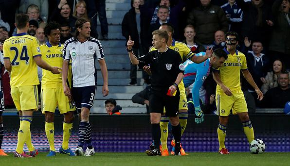 Referee Mike Jones (C) gestures towards West Bromwich Albion's Swedish defender Jonas Olsson (3L) after showing a red card to Chelsea's Spanish midfielder Cesc Fabregas (R)