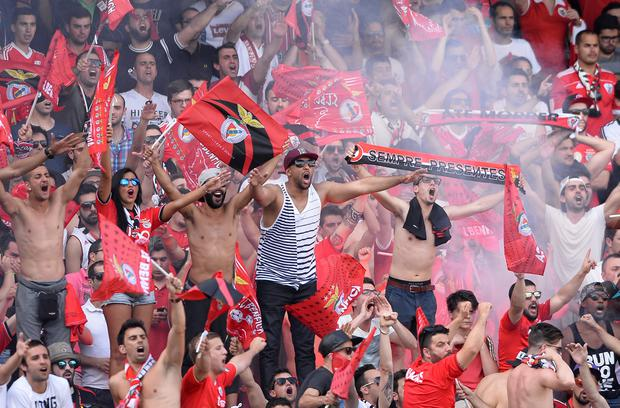 Benfica's supporters jubilate before the start of the Portuguese league football match Vitoria SC vs SL Benfica at the Dom Afonso Henriques stadium in Guimaraes on May 17, 2015. The match finished with a 0-0 draw and Benfica won the 2014-15 Portuguese league. AFP PHOTO / MIGUEL RIOPAMIGUEL RIOPA/AFP/Getty Images