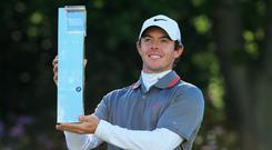 Rory McIlroy of Northern Ireland poses with the trophy following his victory at the end of day four of the BMW PGA Championship at Wentworth on May 25, 2014 in Virginia Water, England.